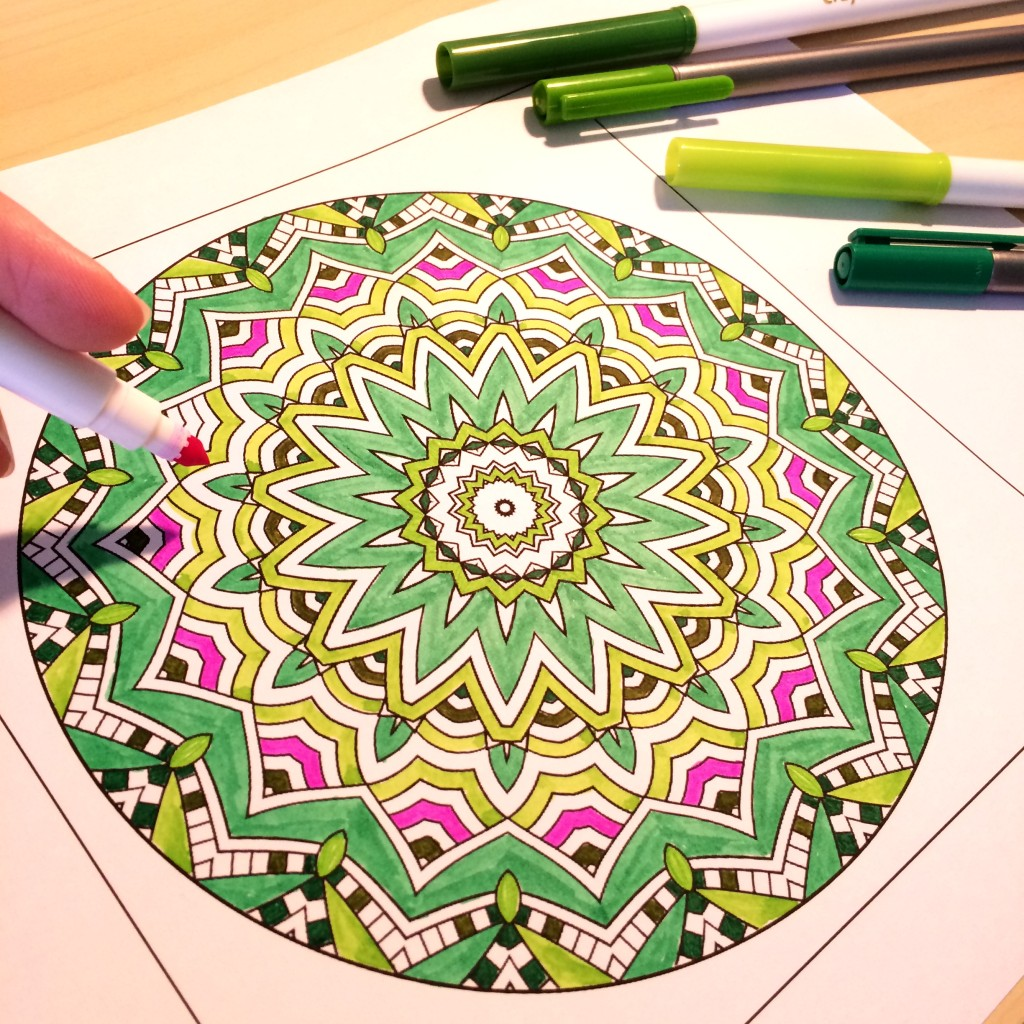 Coloring in a mandala from Coloring to Calm Vol. 1